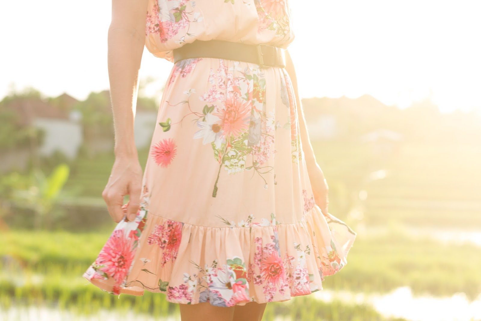 Fashion blogger, Alison Hutchinson, is wearing a KAYVALYA Rosie off the shoulder dress in pink floral