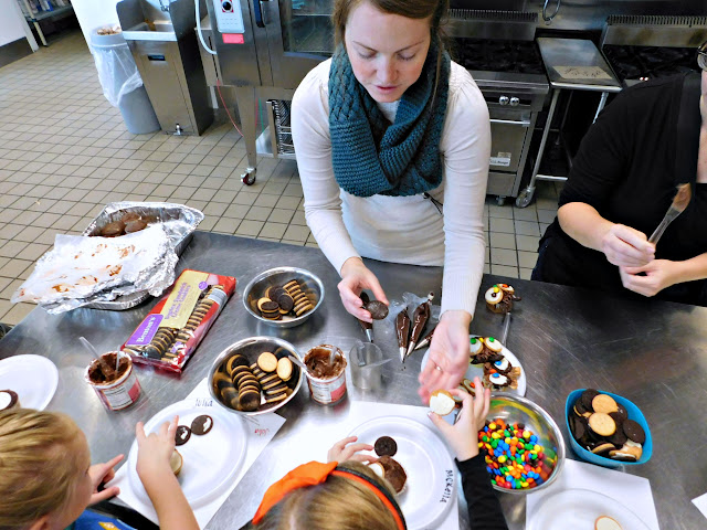 Troop leader helping in the Kitchen with Girl Scouts of North East Ohio