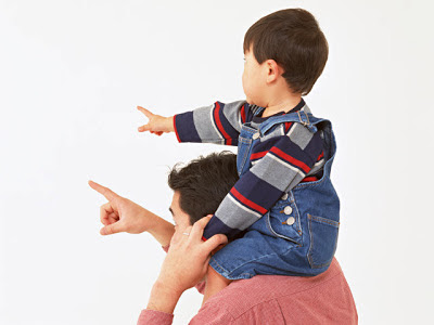 namc montessori encourages toddler independent play child on shoulders pointing
