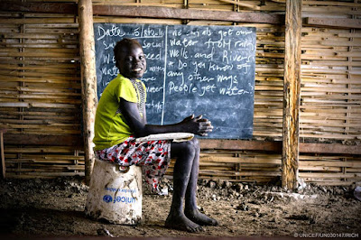Nyayang, 10, doesn't have a chair to sit on in class in South Sudan
