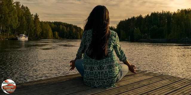 "Header image of the article: ""11 Reasons To Start Believing In Yourself"". Girl meditating"