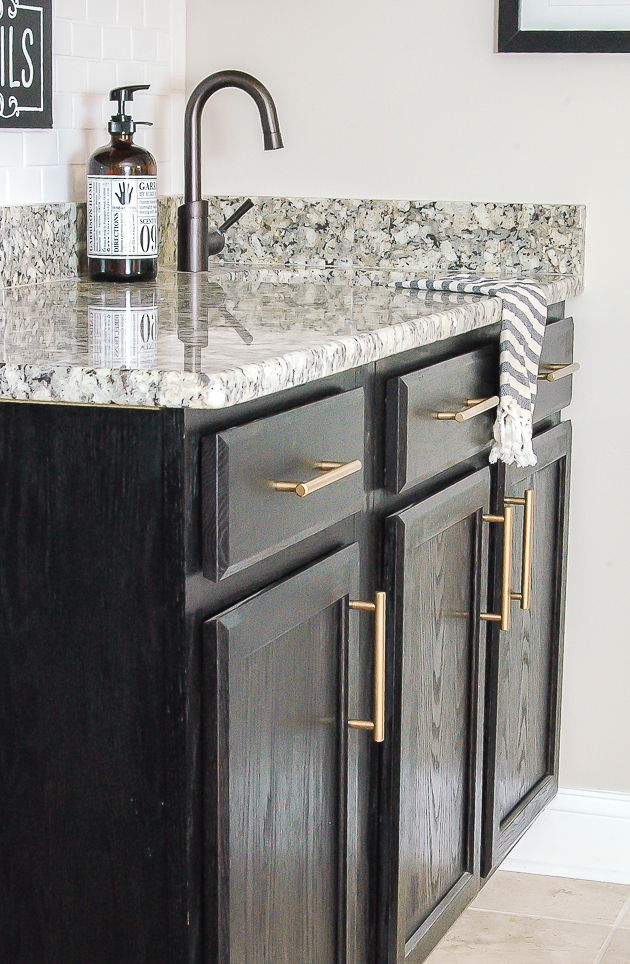 basement bar dark cabinets gold hardware
