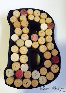 One year of crafts. How to make a diy monogram wine cork holder display using paper mache