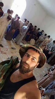 صور السيلفي تصل مليشيا بابليون النصرانية في تعذيب أهل الصقلاوية