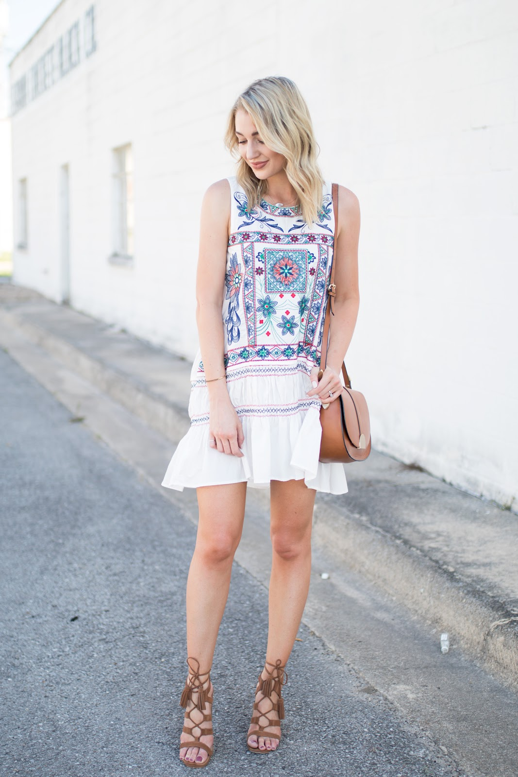 White dress with colorful embroidery