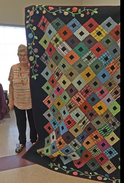 Sue Welton, a Beaumont, TX quilter with her thrift store shirt quilt