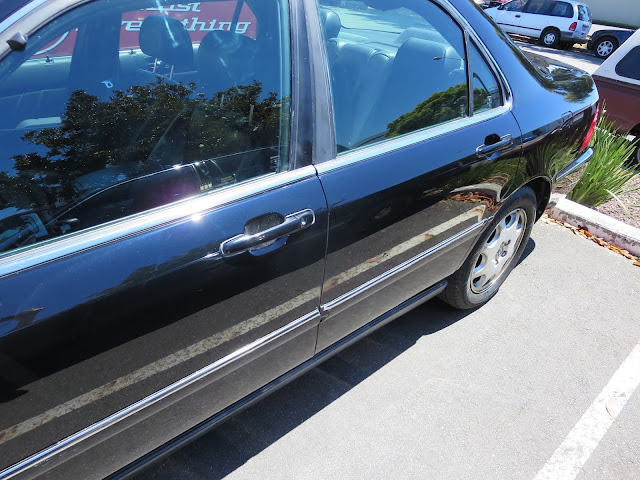 Rear door on Acura RL after repairs at Almost Everything Auto Body