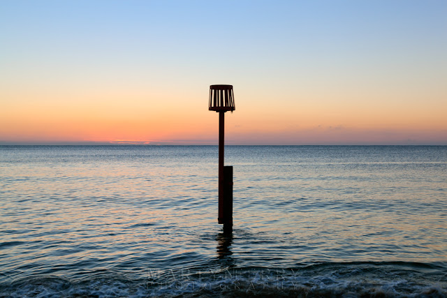 Image of the ocean at Swanage in Dorset at sunrise.