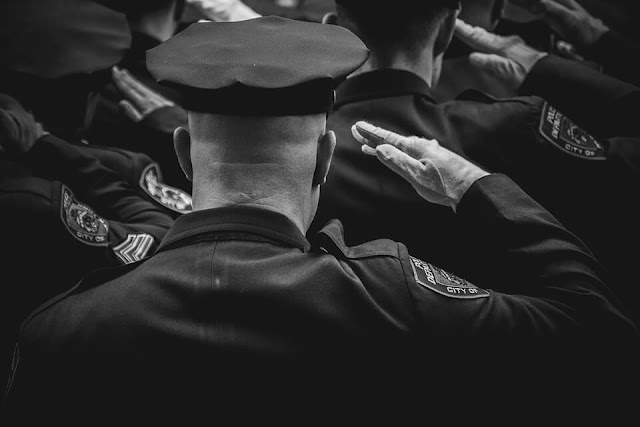 police black and white salute
