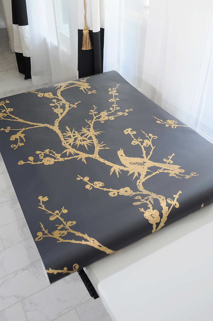 The black & gold bird watching Tempaper by Cynthia Rowley looks amazing in this master bedroom!