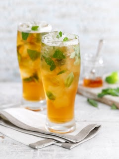 Honey Badger Cocktail in a pint glass with lots of ice and mint