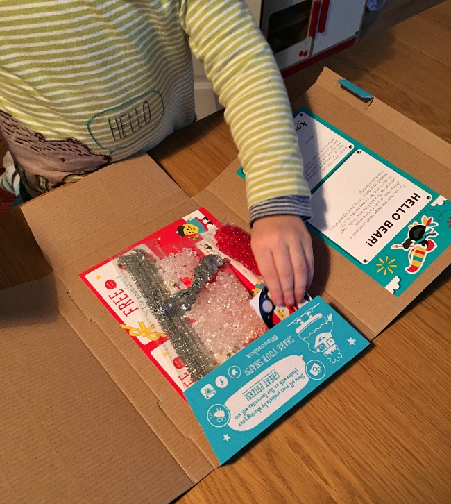 toucanBox-Subscription-Box-review-toddler-looking-at-the-contents-of-the-box