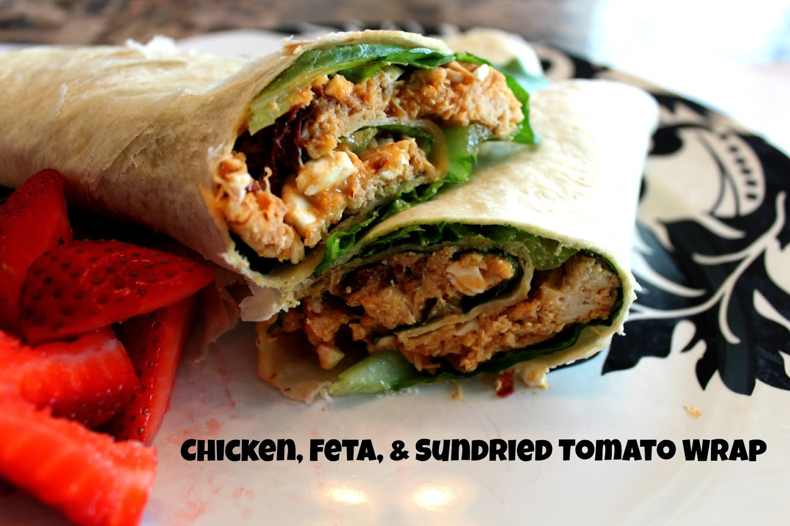 Chicken, Feta, and Sundried Tomato Wrap Sandwich:- two large tortillas - 1 to 1 1/2 cups seasoned shredded chicken - 1/4 cup feta cheese - 1/4 cup drained oil-packed sundried tomatoes - 2 tbsp. Italian dressing - desired amount of romaine lettuce