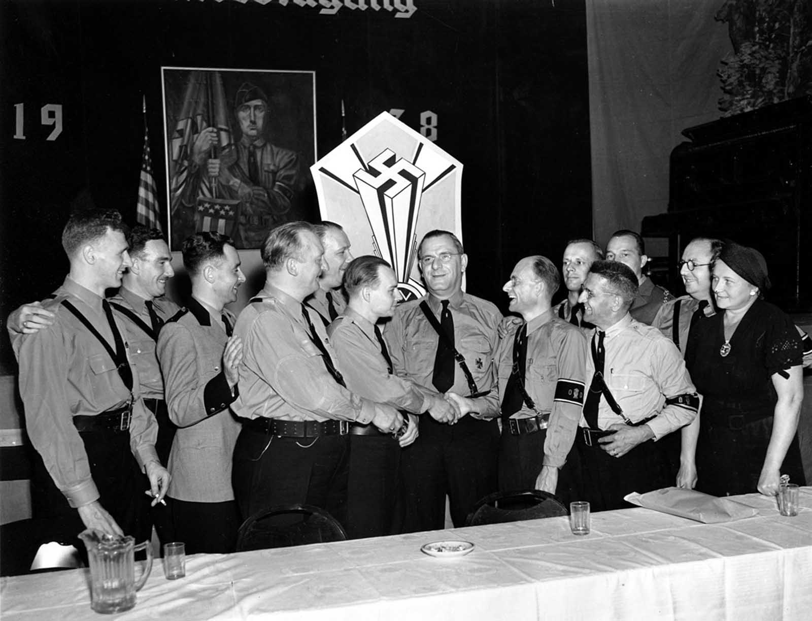 Fritz Kuhn, center facing forward, is congratulated by fellow officers of the German-American Bund in New York on September 4, 1938. Kuhn was unanimously re-elected on September 3 as National leader of the Bund, a pro-Nazi organization holding its sixth annual convention.