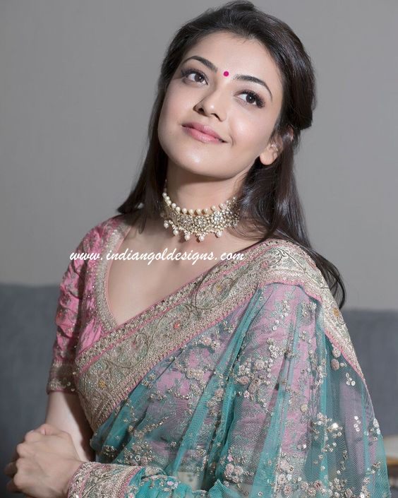 Latest saree designs kajal agarwal in green work saree checkout kajal agarwal in green work saree with work border and paired with matching short sleeves blouse altavistaventures Image collections