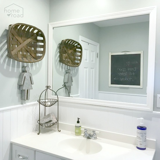 View of painted walls, framed mirror and vanity