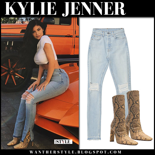 Kylie Jenner in white crop top, ripped jeans and snake skin boots yeezy 90s style july 26