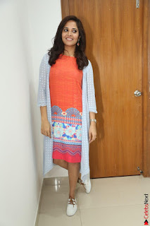 Actress Anasuya Bharadwaj in Orange Short Dress Glam Pics at Winner Movie Press Meet February 2017 (45).JPG