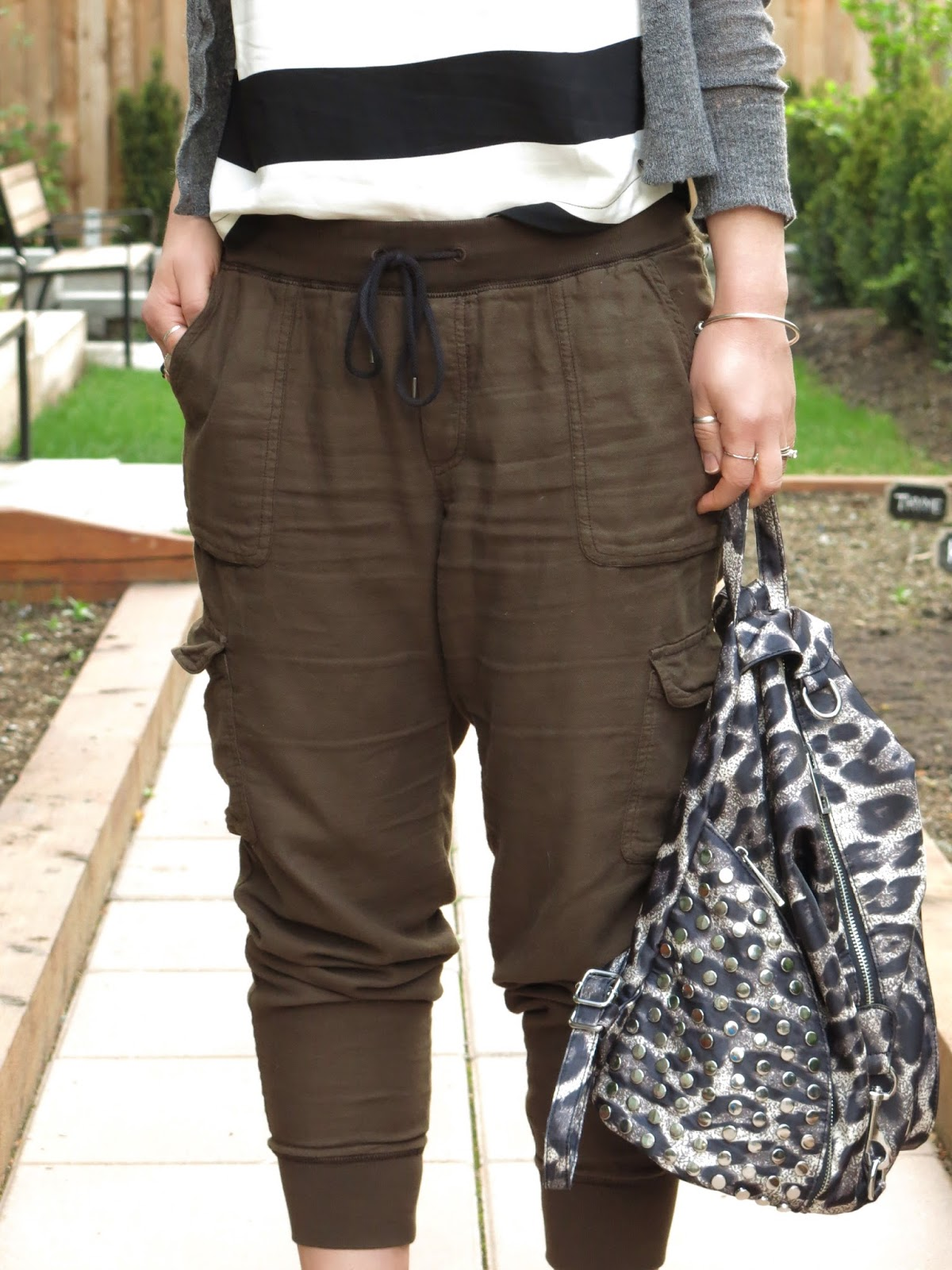 slouchy cargo pants, striped tank top, shrunken cardigan, studded ankle-strap sandals, leopard-print backpack