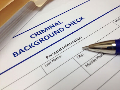 Cropped photo of a criminal background check form