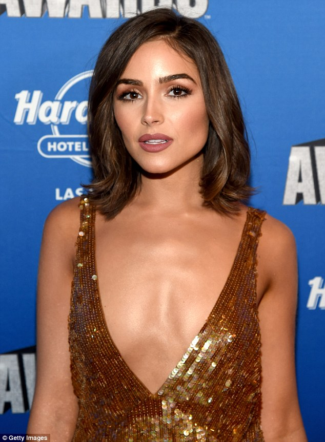The 24-year-old actress wore a plunging bronze dress which showed off lots of flesh