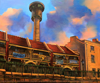 plein air oil painting of heritage terraces Millers Point & Harbour Control Tower with protest banners by Friends of Millers Point by industrial heritage artist Jane Bennett