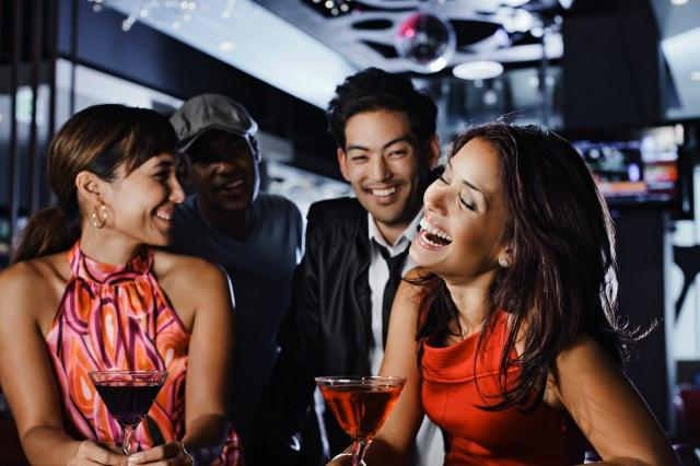 Picture of friends at a bar having drinks