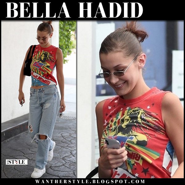 Bella Hadid in red printed t-shirt dior mania and ripped jeans model casual style august 9