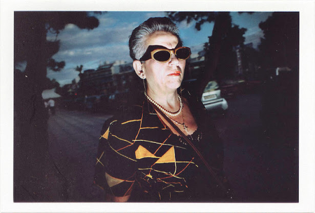 dirty photos - Once - street photo of woman and shadow of sunglasses from flash