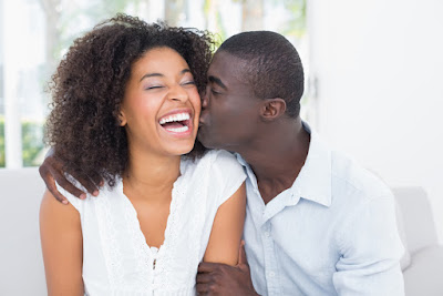 black-couple-dating-happy-kissing-laughing