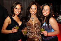 Myrna Star and other babes holding a drink in a nightclub