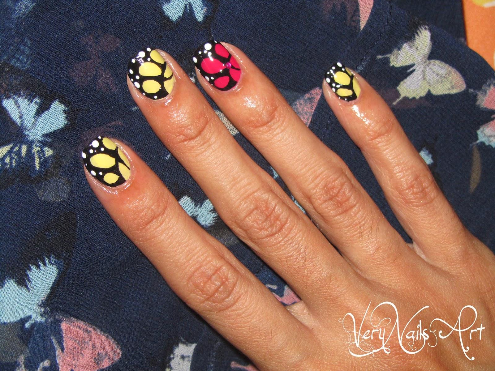 Diseño de uñas ala de mariposa