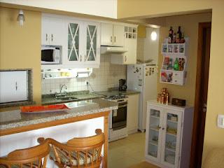 Cozinha e churrasqueira - Apartamento Temporada Gramado