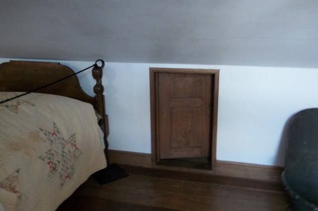 Underground Railroad = Secret attic access slide bed over to hide the door.
