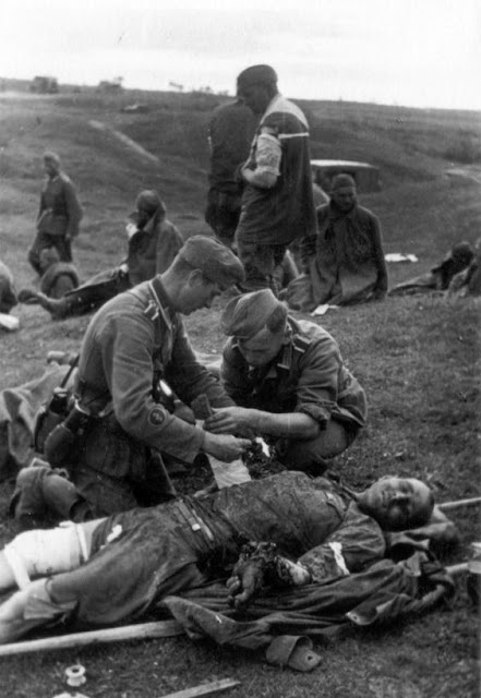 Wounded Soviet soldier being treated by German medic, 22 July 1941 worldwartwo.filminspector.com
