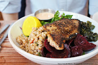 Porgy with Harissa Cashew Sauce with three sides (Sauteed Spinach with Garlic, Farro with Olives & Cherry Tomatoes, Roasted & Pickled Beets) at Seamore's