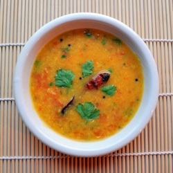 Tomato Dal soup filled with curry spices Ginger, mustard seeds, asafetida, chili powder, chili peppers, turmeric, serranos
