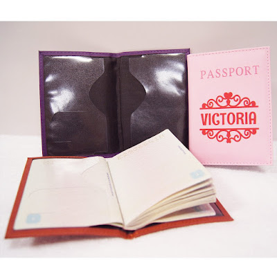 Shows inside of passport cover and passport.