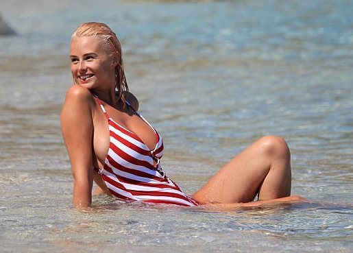 Rhian Sugden shone in a plunging candy cane-style swimsuit