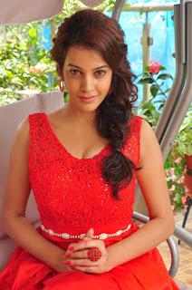 Actress Deeksha Panth Stills in Red Short Dress at Banthi Poola Janaki Press Meet 0056