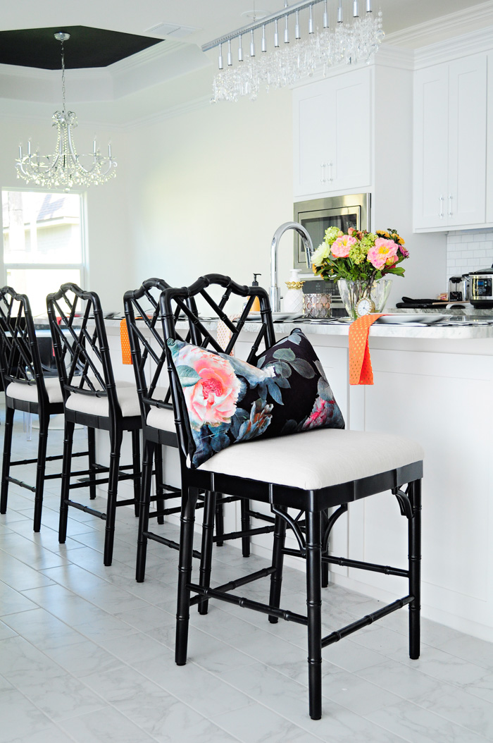 These chinoiserie counter height barstools keep this open concept white kitchen feeling stylish and chic.