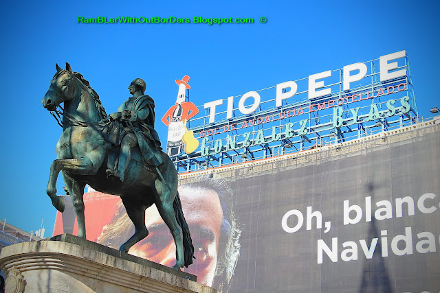 Billboard of Tio Pepe and statue of Charles III, Puerta del Sol, Madrid, Spain