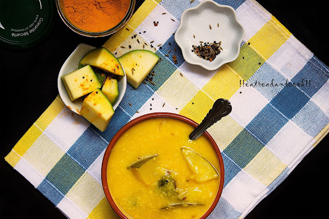 bengali recipe and preparation Kancha Aamer Tok Dal recipe / Aam Dal recipe / Green Mango Dal recipe with step by step pictures