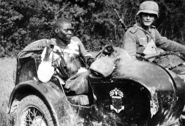 29 June 1940 worldwartwo.filminspector.com German motorcyclist French black African soldier