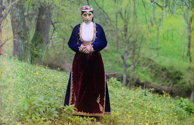 An Armenian woman in national costume poses for Prokudin-Gorskii on a hillside near Artvin (in present day Turkey), circa 1910.