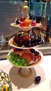 Fruit platters in glass stacked on top of each other