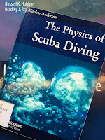 The Physics of Scuba Diving, by Marlow Anderson, superimposed on Intermediate Physics for Medicine and Biology.