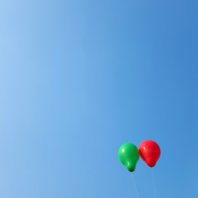 A Minimalist Photo of two balloons in the sky shot by Samsung Galaxy S6 Mobile Phone
