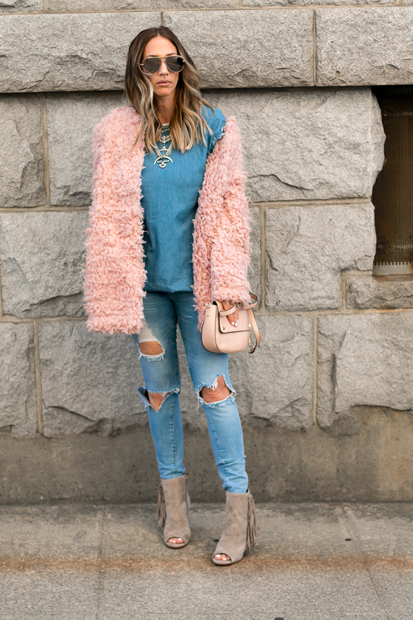 pink furry coat with all denim jeans