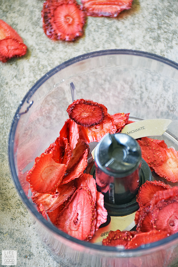 Chopping dried strawberries to use in Strawberry Pancakes Recipe
